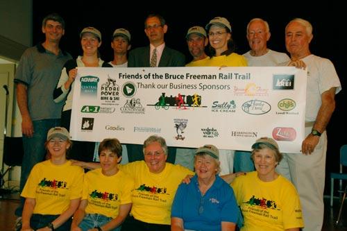 BFRT Board Members with Sponsors Banner